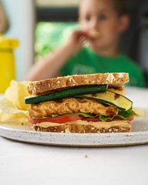 Smoky tofu, zucchini, and zesty ranch club sandwiches