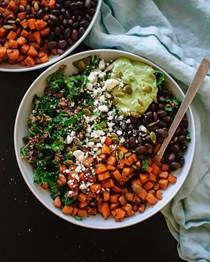 Southwestern kale power salad with sweet potato, quinoa & avocado sauce