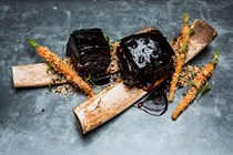 Soy-marinated and braised beef short rib with pickled carrots and crushed peanuts