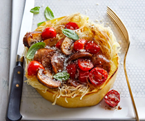 Spaghetti squash nests with sausage, mushrooms & tomatoes