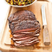 Spice-rubbed flank steak with toasted corn and black bean salad