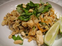 Spicy fried rice with bean sprouts, chicken, and peanuts