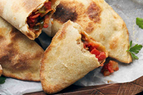 Spicy tomato-filled Tunisian flatbreads