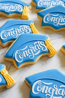Stenciled graduation cap cookies