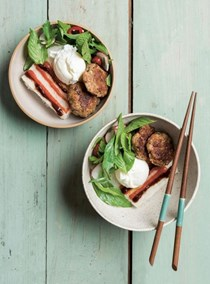 Sticky rice with ginger sausage, herb salad, and poached eggs