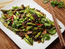 Stir-fried spring vegetables with black olives and Sichuan peppercorn