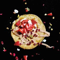 Strawberry and tahini crepes with pomegranate seeds and toasted pistachios