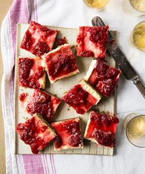 Strawberry jam cheesecake bars with buckwheat-almond crust