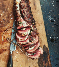 Stuffed flank steak with peppery greens and goat cheese