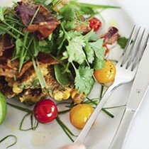 Sweet corn fritters with roast tomatoes, spinach and bacon