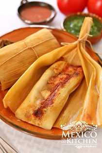Sweet corn tamales stuffed with pork in chipotle sauce (Chanchamitos)
