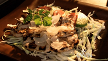 Tangy Yucatecan grilled pork with roasted onions and fresh garnishes (Poc chuc)