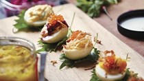 Thai-style deviled eggs with crab mayo and crispy shallots