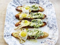 Toasts with ramp butter and fried quail egg