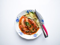Tomato and paprika braised sausages with charred lettuce