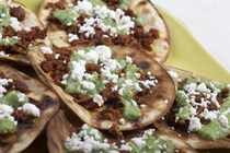 Tostadas with chorizo, tangy guacamole and fresh cheese