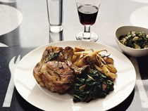 Tray-baked pork chops with herby potatoes, parsnips, pears and minted bread sauce