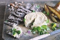 Truffled cashew cheese with seeded crackers and caramelised pears