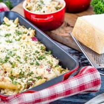 Turkey & ham pasta bake with lemon & herb Parmigiano Reggiano crust