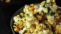 Turmeric-dusted popcorn with parsley oil