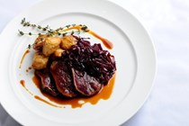 Venison leg cooked in hay with celeriac & braised red cabbage [Simon Rogan]