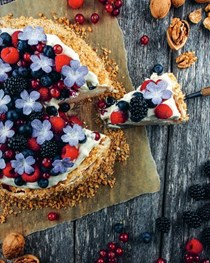 Walnut Pavlova with whipped cream and berries