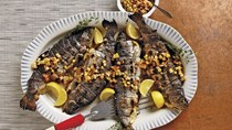 Whole grilled trout with charred corn and black-plum chowchow
