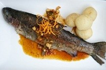 Whole rainbow trout with orange, maple syrup and macadamia nuts